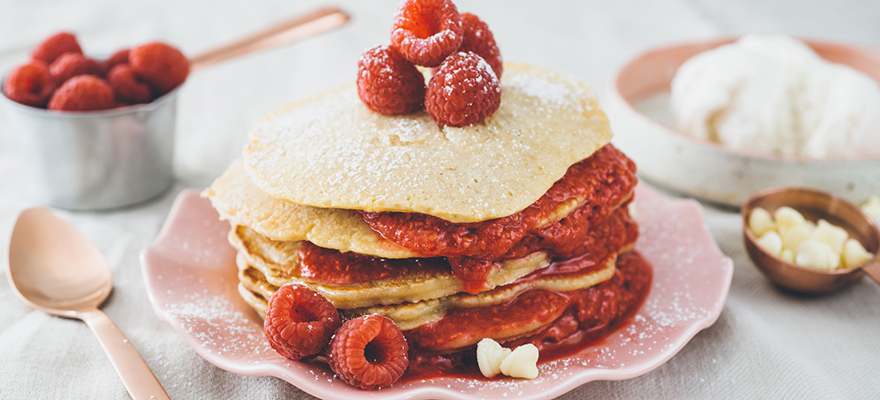 White chocolate pancakes with raspberry coulis