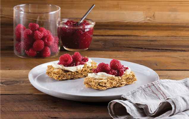 Raspberries and cream cheese on Weet-Bix™