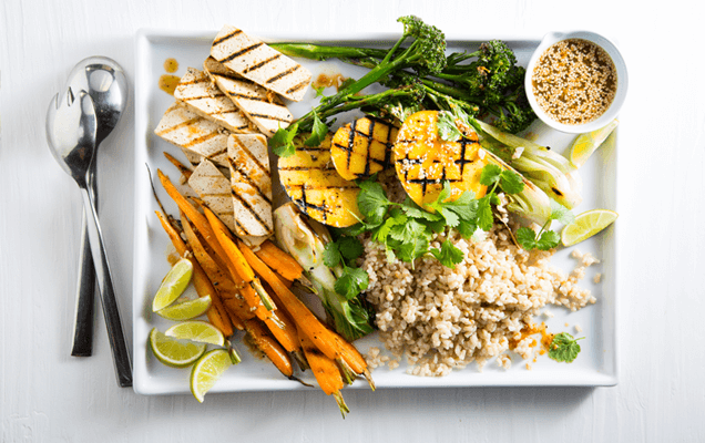 Fragrant coconut sticky rice with grilled mango and vegetables