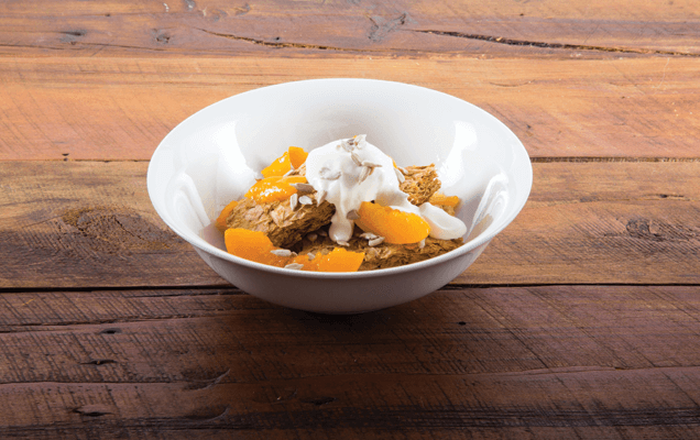 Weet-Bix™ with peaches, sunflower seeds and yoghurt